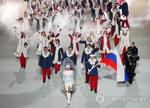 俄罗斯国旗不会出现在平昌冬奥,图为俄罗斯体育代表团亮相索契冬奥开幕式。(韩联社)