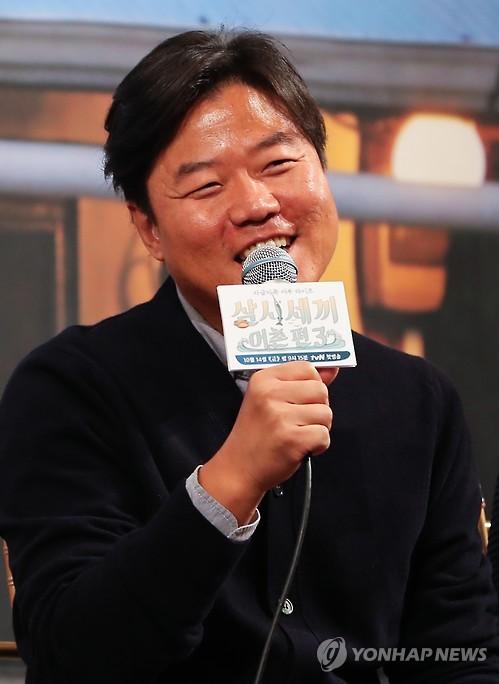 制作人罗�N�(韩联社)
