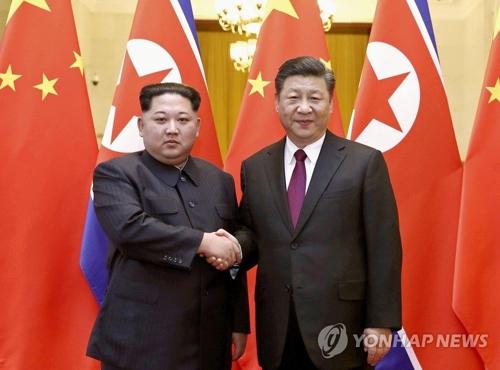 资料图片:金正恩与习近平会晤。(韩联社/美联社)