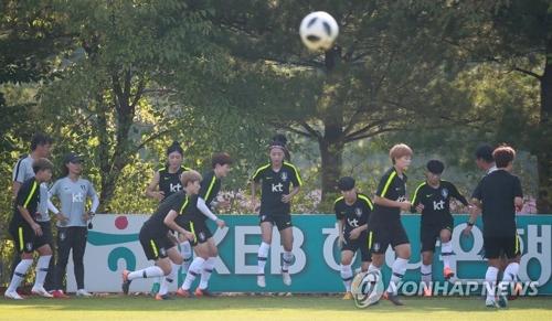 女足冒着酷热备战亚运。(韩联社)