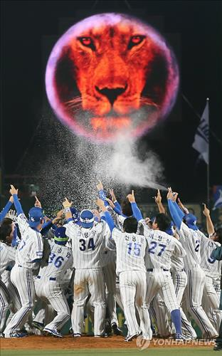 Members of the Samsung Lions celebrate their third straight KBO championship on Nov. 1, 2013, in Daegu. They will be chasing their fourth straight title in 2014. (Yonhap file photo)