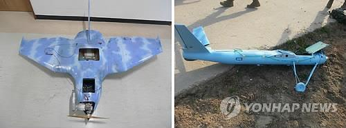 The two unmanned aerial vehicles found near the inter-Korean border -- one (L) found in Paju, just south of the demilitarized zone, on March 24, 2014 and the other drone discovered on Baengnyeong Island on April 1, 2014 (Yonhap)