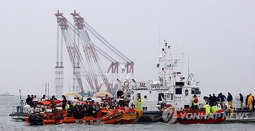 Search and rescue operations are under way on April 19, 2014, in waters off South Korea's southwestern island of Jindo to find hundreds of missing people in a ferry that sank three days ago. (Yonhap)