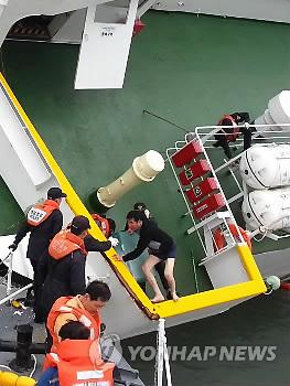 The sunken ferry Sewol's captain, Lee Jun-seok, wearing just his underwear, gets off his sinking boat, leaving hundreds of passengers behind on April 16, 2014. The tragedy killed 188 people and left 144 others unaccounted for as of April 28, 2014. (Yonhap)