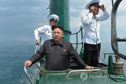 This Rodong Sinmun photo released on June 16, 2014, shows North Korean leader Kim Jong-un aboard a submarine during his visit to the North's Naval Unit 167 stationed on the east coast. (Yonhap)