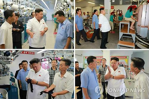 North Korean leader Kim Jong-un tours the Pyongyang Hosiery Factory in the nation's capital. (KCNA-Yonhap)