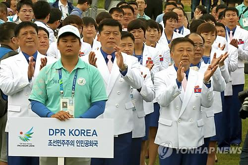 The North Korean team attends a welcome ceremony at the athletes' village of the 17th Asian Games on Sept. 18, 2014. (Yonhap)