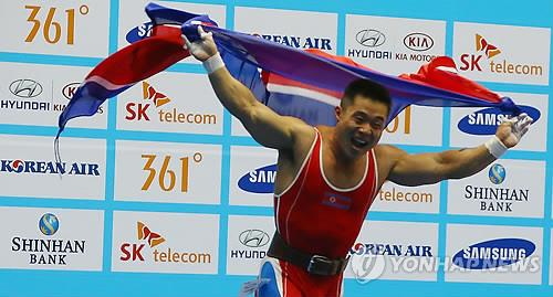 Weighlifter Kim Un-guk of North Korea shouts in joy after winning the gold medal at the Incheon Asian Games on Sept. 20, 2014. (Yonhap)