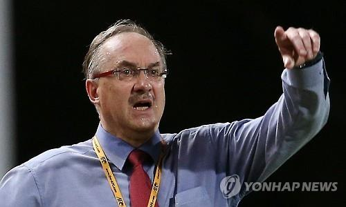 South Korea head coach Uli Stielike gives orders to his team during a World Cup qualifier against Myanmar in Bangkok on June 16, 2015. (Yonhap)