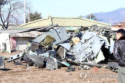 Parts of a crashed Army helicopter are scattered about a civilian farm in Chuncheon, Gangwon Province, on Feb. 15, 2016, during an inspection flight. Three of the four men aboard died while being treated at hospitals. The pilot, the lone survivor, is in critical condition. (Yonhap)