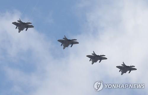 U.S.F-22 stealth fighters fly above Osan Air Base on Feb. 17, 2016 in a demonstration of military power against North Korea. (Yonhap)