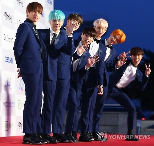 Middle east k pop fans get to meet bts taeyeon bts poses for pictures before attending the seoul music awards on jan 14 2016 m4hsunfo