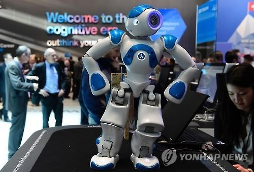A robot from IBM's Watson AI project is on display at the CEBIT digital business expo in Hanover, Germany. (AFP-Yonhap)