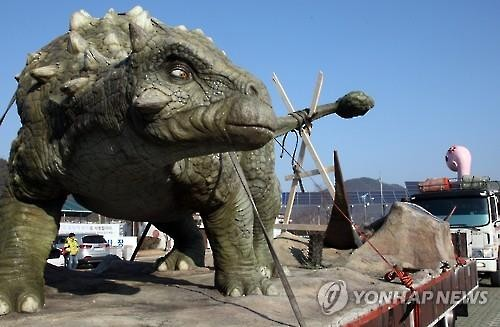 Preparations are underway for the Gyeongnam Goseong Dinosaur World Expo a week before the opening of the event on April 1. (Yonhap)