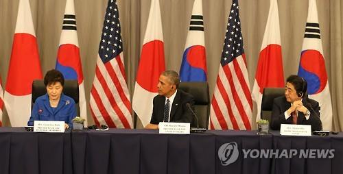 President Park Geun-hye speaks in a joint news conference with U.S. President Barack Obama and Japanese Prime Minister Shinzo Abe after their trilateral summit on the margins of the Nuclear Security Summit in Washington on March 31, 2016 (Yonhap)