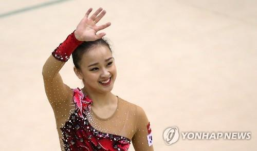 In this file photo taken on April 9, 2016, South Korean rhythmic gymnast Son Yeon-jae waves to fans at the National Training Center in Seoul. (Yonhap)