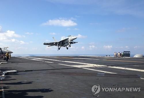 An FA-18 jet fighter takes off from the USS John C. Stennis, aircraft carrier in the South China Sea on April 15, 2016, in this photo released by the Associated Press. (Yonhap)