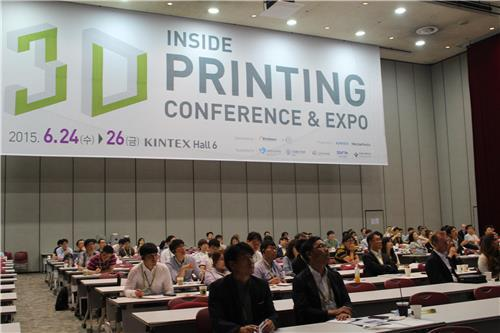 Participants at the Inside 3D Printing Conference & Expo hold a forum on the industry's future at the KINTEX exhibition center in Goyang, just northwest of Seoul, on June 23, 2016. (Yonhap)