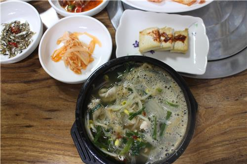 A bowl of squid intestine soup is served at a restaurant in Ulleung Island, South Korea, on June 29, 2016. (Yonhap)
