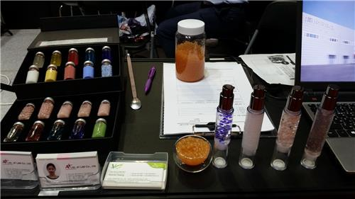 "This photo taken on July 7, 2016, shows cosmetics ingredients displayed in a booth set up by a Chinese company during the ""in-cosmetics Korea exhibition"" held at COEX hall in southern Seoul from July 6-7. (Yonhap)"