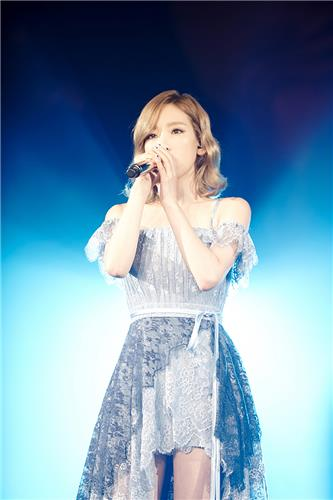 Taeyeon from Girls' Generation performs in her first solo concert in this photo provided by S.M. Entertainment, taken on July 10, 2016. (Yonhap)