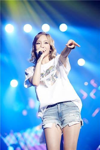 Taeyeon, from Girls' Generation, smiles at the crowd in her first solo concert on July 10, 2016, in this photo provided by S.M. Entertainment. (Yonhap)
