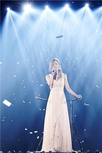 Taeyeon of Girls' Generation sings passionately in her first solo concert on July 10, 2016, in this photo provided by S.M. Entertainment.