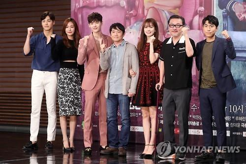 "Director Jung Dae-yoon (C), Han Hyo-joo (3rd from R), Lee Jong-suk (3rd from L) and other members of the cast pose for a photo during a press conference for their upcoming TV drama ""W"" at the MBC headquarters in Seoul on July 18, 2016. (Yonhap)"