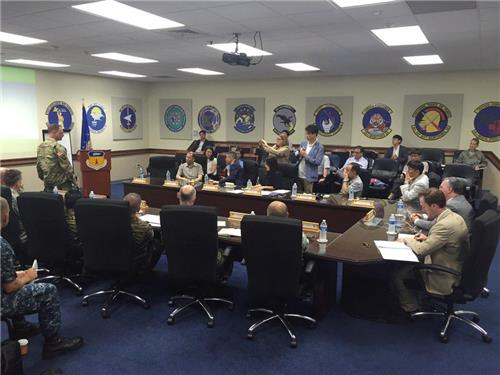 This photo, taken on July 18, 2016, and provided by the U.S. Air Force, shows S. Korean reporters attending a briefing by the U.S. military forces in Guam on its THAAD battery. (Yonhap)