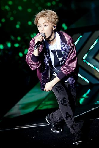 "Xiumin of South Korean boy group EXO performs during the group's Seoul concert ""EXO Planet #3 - The EXO'rDIUM"" at Olympic Park stadium, southeastern Seoul, on July 24, 2016. (Yonhap)"