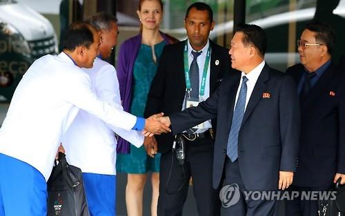 Choe Ryong-hae (second from R), vice chairman of North Korea's State Affairs Commission, shakes hands with an official of the North Korean athletic delegation to the Rio de Janeiro Summer Olympics after arriving in the Brazilian city on Aug. 4, 2016. (Yonhap)