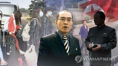 Seoul said last week that Thae Yong-ho (C), a minister at the North Korean embassy in London, has defected to the South. (Yonhap)