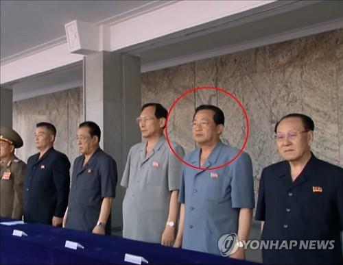South Korea's unification ministry said on Aug. 31, 2016, that North Korea has executed Kim Yong-jin, a North Korean vice premier, by firing squad last month. This photo carried by North Korea's state media shows Kim (2nd from R) attending an event in early July to celebrate the election of North Korean leader Kim Jong-un as the chairman of the Commission on State Affairs. (For Use Only in the Republic of Korea. No Redistribution) (Yonhap)