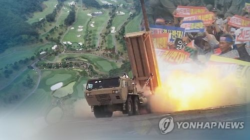 This undated file image shows an interceptor fired from a THAAD launcher against the background of a golf course in Seongju and local residents protesting the THAAD deployment due to health concerns. (Yonhap)