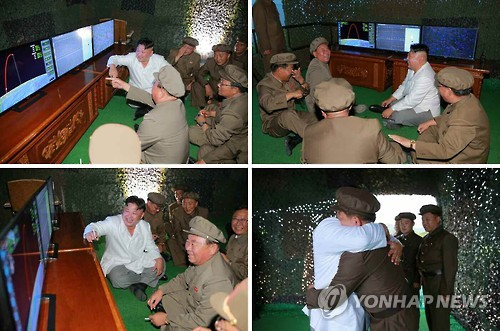 In these photos taken on Aug. 24, 2016, North Korean leader Kim Jong-un (in white jacket) supervises the test-firing of a submarine-launched ballistic missile in North Korea. (For Use Only in the Republic of Korea. No Redistribution) (Yonhap)