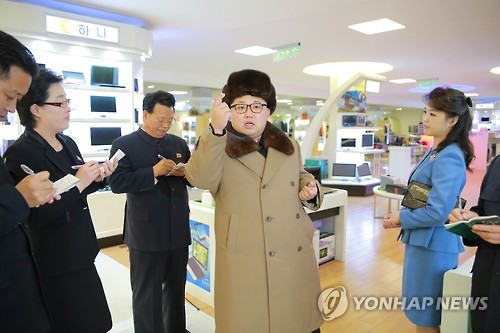 Ri Sol-ju (R) accompanies her husband and North Korean leader Kim Jong-un on a visit to the Mirae Shop in Pyongyang on March 28, 2016. (For Use Only in the Republic of Korea. No Redistribution) (KCNA-Yonhap file photo)