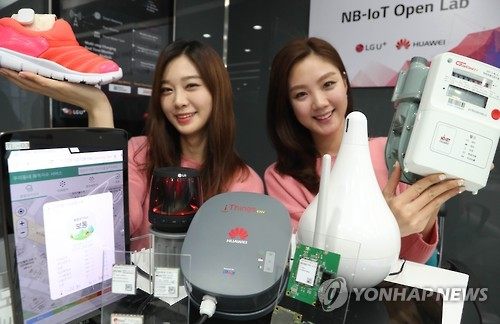 Models Show Off Various Trial Products Equipped With The Internet Of Things Technology At Headquarters