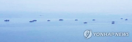 This Yonhap file photo taken on June 7, 2016, shows a group of Chinese boats fishing in North Korean waters in the West Sea. (Yonhap)