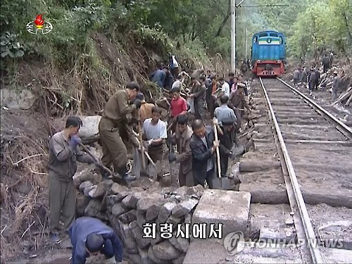 Workers from North Korea's Ministry of Railways engage in restoring a railway hit by floods in Heoryong, northeastern North Korea, in this photo taken from footage of the North's Korean Central TV Broadcasting Station on Sept. 10, 2016. (For Use Only in the Republic of Korea. No Redistribution) (Yonhap)
