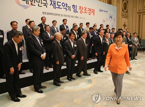 The file photo, taken on July 24, 2015, shows South Korean President Park Geun-hye (R) leaving the venue of a luncheon with top business leaders at the presidential office Cheong Wa Dae. The president is said to have separately met at least seven business leaders, including Hanjin Group chairman Cho Yang-ho (first row, second from L) and Hyundai Motor Group chairman Chung Mong-koo (front row, fifth from L), to personally ask for donations for two sports organizations set up and controlled by her longtime friend Choi Soon-sil. (Yonhap)