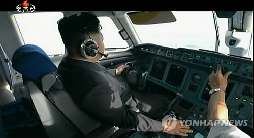 This footage captured from North Korea's Korean Central Television on Dec. 30, 2014, shows North Korean leader Kim Jong-un seated in the cockpit of an airplane. (For Use Only in the Republic of Korea. No Redistribution) (Yonhap)