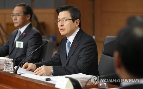 Shinzo Abe Japan PM urges South Korea to remove 'comfort woman' statue