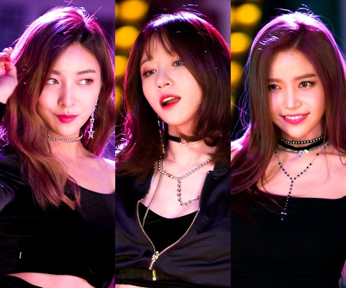 This image, provided by Mystic Entertainment, shows South Korean girl group members Luna of f(x), Hani of EXID and Solar of Mamamoo (L to R). (Yonhap)