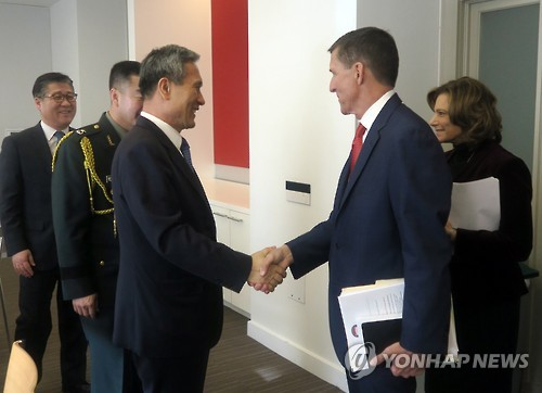 South Korea's National Security Office chief Kim Kwan-jin (L) shakes hands with U.S. National Security Advisor Mike Flynn prior to their talks in Washington on Jan. 9, 2017, in this photo released by the South Korean Embassy in the U.S. capital. (Yonhap)