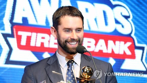 In this file photo taken on Nov. 14, 2016, Dustin Nippert of the Doosan Bears smiles after receiving the Korea Baseball Organization MVP trophy at a ceremony in Seoul. (Yonhap)