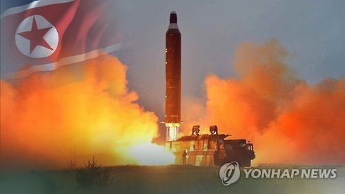 This undated captured image from Yonhap News TV shows a ballistic missile about to be fired from a mobile launcher in North Korea. (Yonhap)