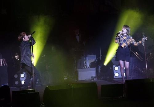 The photo provided by YG Entertainment shows duo AKMU performing on stage in Shanghai in December. (Yonhap)