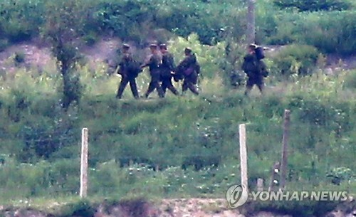This file photo, dated Aug. 26, 2015, shows a group of soldiers walking out of a sentry post in Kaepung on the North's western front-line. (Yonhap)