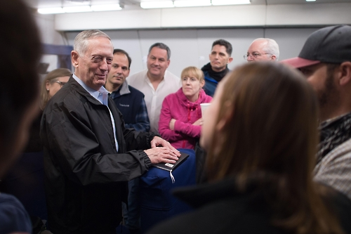 Defense Secretary Jim Mattis answers questions from reporters during a flight to South Korea. Photo courtesy of the Defense Department.