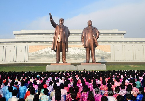 This file photo, released by the North's official Korean Central News Agency on Nov. 14, 2016, shows people offering flowers at the bronze statues of founder Kim Il-sung and his late son Kim Jong-il on Mansudae Hill in Pyongyang. (For Use Only in the Republic of Korea. No Redistribution) (Yonhap)